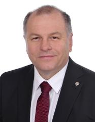 Realitní makléř  Miloš Toman
